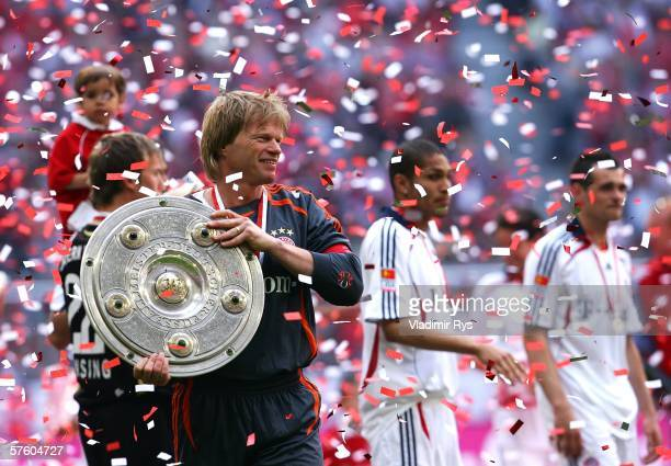 Oliver Kahn of Bayern celebrates with the trophy for the German Champion after the Bundesliga match between FC Bayern Munich and Borussia Dortmund at...