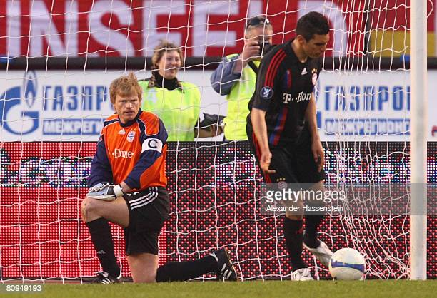 Oliver Kahn of Bayern Munich and his team mate Lucio look dejected after receiving the 3rd goal during the UEFA Cup semi final 2nd leg match between...