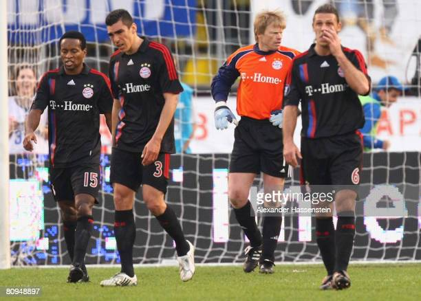 Oliver Kahn of Bayern Munich and hist team mates Ze Roberto Lucio and Martin Demichelis look dejected after receiving the second goal during the UEFA...