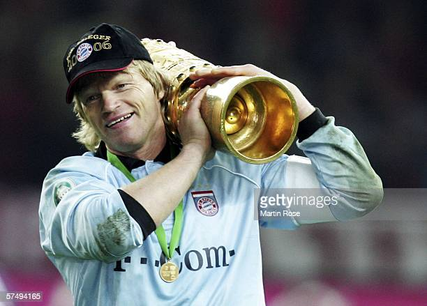 Oliver Kahn of Bayern Munich carries the trophy after winning the DFB German Cup final between Bayern Munich and Eintracht Frankfurt at the Olympic...