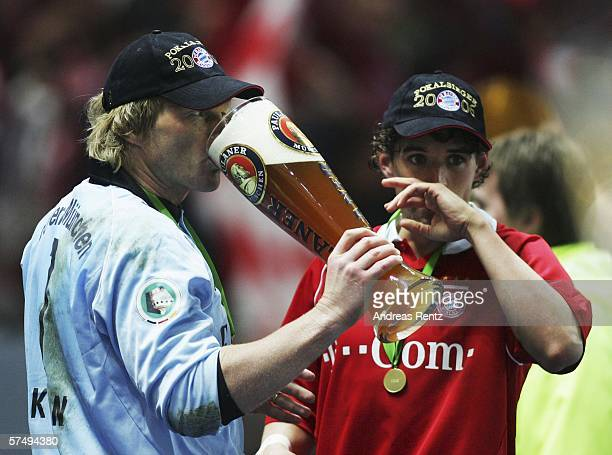 Oliver Kahn of Bayern Munich shares a beer with team mate Owen Hargreaves after winning the DFB German Cup final against Bayern Munich and Eintracht...