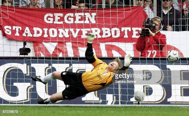 Oliver Kahn of Munich fails to save the third goal during the Bundesliga match between FC Bayern Munich and 1 FC Cologne at the Allianz Arena on...