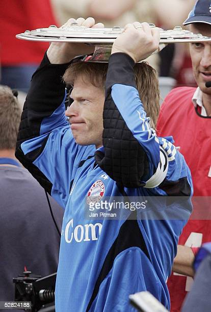 Oliver Kahn of Munich places the trophy on his head after the 1 Bundesliga match between FC Bayern Munich and 1 FC Nuremberg at the Olympic Stadium...