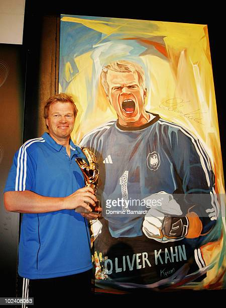 Oliver Kahn poses in front of a portrait of himself to be auctioned during the adidas Penalty Day at the Jo'bulani Centre on June 25 2010 in Sandton...