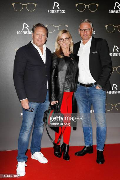 Oliver Kastalio CEO Rodenstock Stefan Bloecher and his girlfriend Stephanie Haupt during the Rodenstock Eyewear Show on January 12 2018 in Munich...
