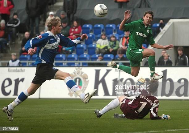 Oliver Kirch of Bielefeld Jonathan Santana of Wolfsburg and Mathias Hain of Bielefeld in action during the Bundesliga match between Arminia Bielefeld...