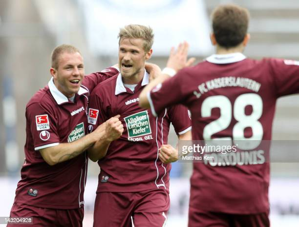Oliver Kirch of Kaiserslautern jubilates with team mates after scoring the first goal during the Bundesliga match between Hertha BSC Berlin and 1FC...