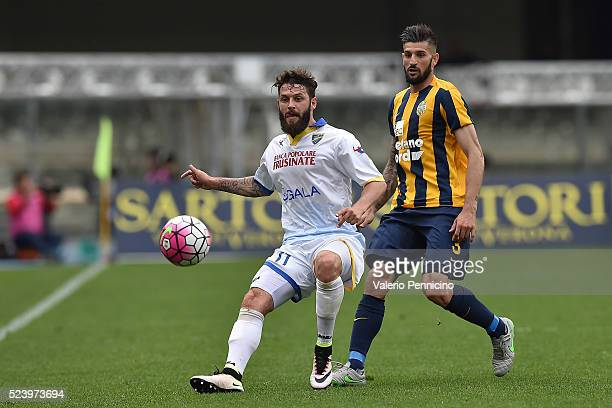 Oliver Kragl of Frosinone Calcio is challenged by Eros Pisano of Hellas Verona FC during the Serie A match between Hellas Verona FC and Frosinone...
