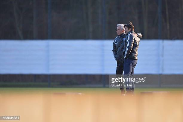 Oliver Kreuzer sports director of Hamburger SV greets head coach Bert van Marwijk during the training session of Hamburger SV on February 11 2014 in...