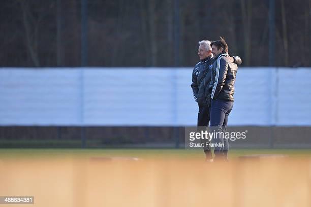 Oliver Kreuzer sports director of Hamburger SV greets head coach Bert van Marwijk during the training session of Hamburger SV on February 11 2014 in...