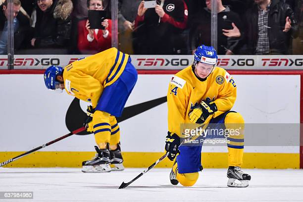 Oliver Kylington and teammate Jens Looke of Team Sweden react after losing to Team Canada during the 2017 IIHF World Junior Championship semifinal...