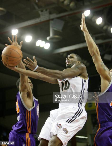 Oliver Lafayette of the Erie BayHawks lays the ball up on two Iowa Energy defenders at Tullio Arena on December 11 2008 in Erie Pennsylvania The...