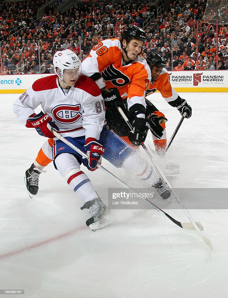 Oliver Lauridsen #38 and Wayne Simmonds #17 of the Philadelphia Flyers battle for position in the corner with Lars Eller #81 of the Montreal Canadiens on April 3, 2013 at the Wells Fargo Center in Philadelphia, Pennsylvania.