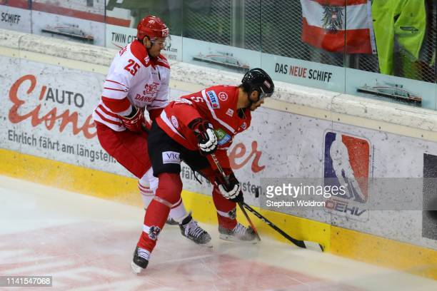 Oliver Lauridsen of Denmark and Thomas Raffl of Austria during the Austria v Denmark - Ice Hockey International Friendly at Erste Bank Arena on May...