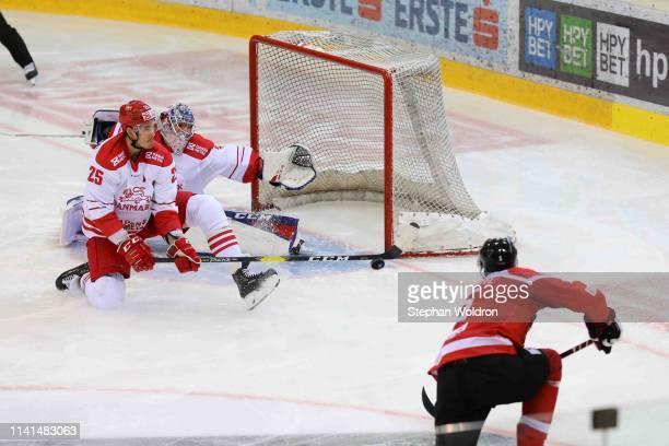 Oliver Lauridsen of Denmark, Sebastian Dahm of Denmark and Thomas Raffl of Austria during the Austria v Denmark - Ice Hockey International Friendly...