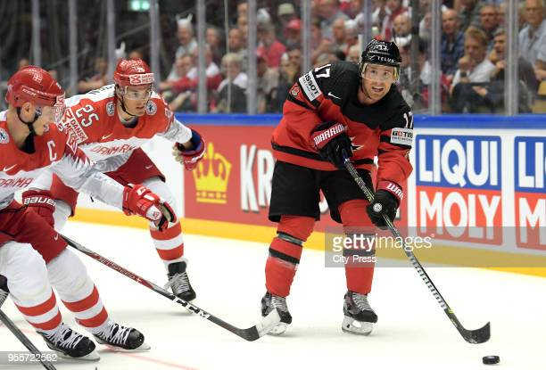 Oliver Lauridsen of Team Denmark and Jaden Schwartz of Team Canada during the IIHF World Championship game between Canada and Denmark at Jyske Bank...