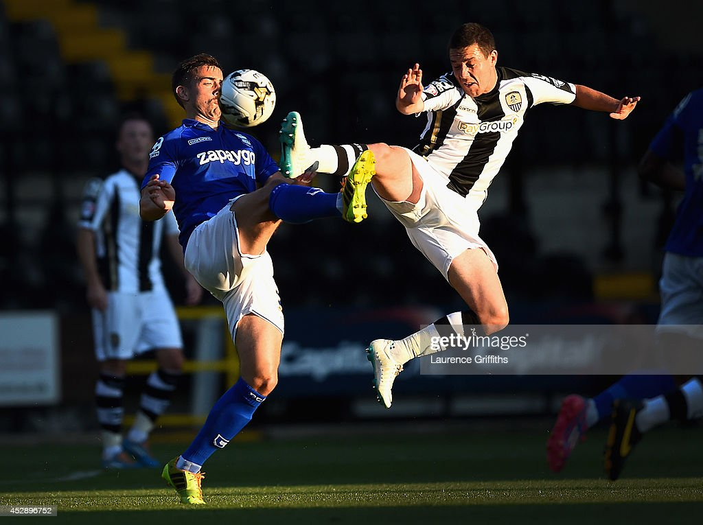 Oliver Lee of Birmingham City battles with Liam Noble of Notts County during the Pre Season Friendly match between Notts County and Birmingham City at Meadow Lane on July 29, 2014 in Nottingham, England.