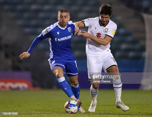 Oliver Lee of Gillingham FC is challenged by Andrew Surman of Milton Keynes Dons during the Sky Bet League One match between Gillingham and Milton...