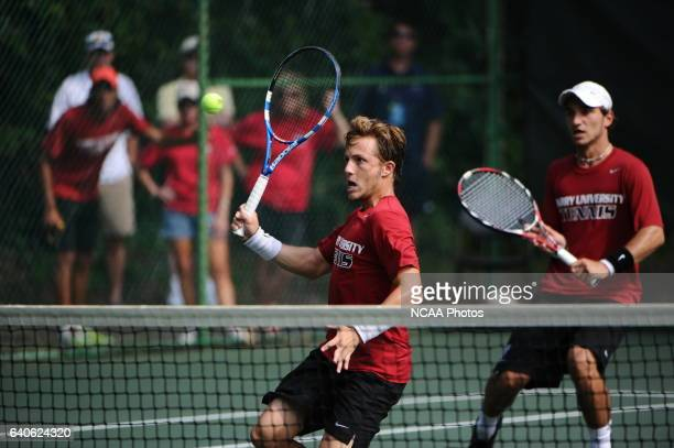 Oliver Lemaitre of Barry University returns a volley against Berney Wallner and Otto Lendhart of Valdosta State during the Division II Men's Tennis...