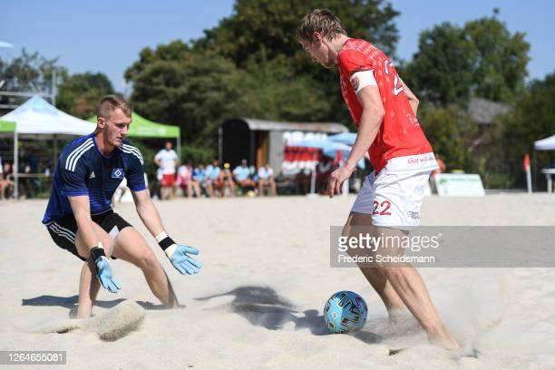 Oliver Levin of Hamburger SV against Tobias Wimmer of Beach Boys Waldkraiburg during the German Beachsoccer League match between team a and team b on...