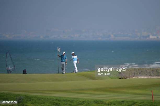 Oliver Lindell of Finland and Clement Sordet of France look on during the final round of the NBO Golf Classic Grand Final at Al Mouj Golf on November...