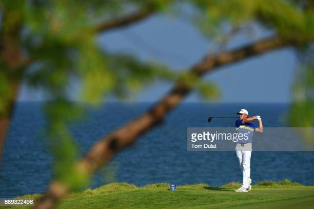 Oliver Lindell of Finland tees off on the 18th hole on Day Two of the NBO Golf Classic Grand Final European Challenge Tour at Al Mouj Golf on...