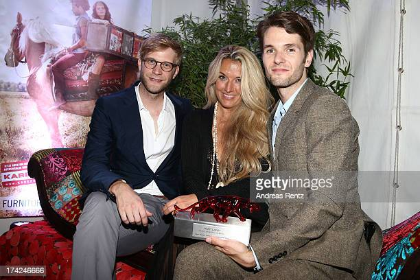 Oliver Luehr Olivia Schoenhofen and Thomas Bentz with the award at KARE Design at the New Faces Award Fashion 2013 at Rheinterrasse on July 22 2013...