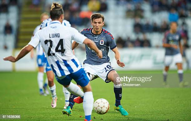 Oliver Lund of OB Odense and Elmar Bjarnason of AGF Arhus compete for the ball during the Danish Alka Superliga match between OB Odense and AGF Arhus...
