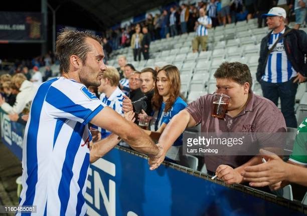 Oliver Lund of OB Odense celebrates with fans after the Danish 3F Superliga match between OB Odense and Randers FC at Nature Energy Park on August 9...