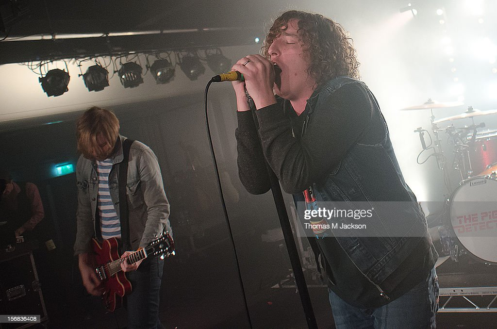 Oliver Main and Matt Bowman of Pigeon Detectives perform onstage at Newcastle University on November 22, 2012 in Newcastle upon Tyne, England.