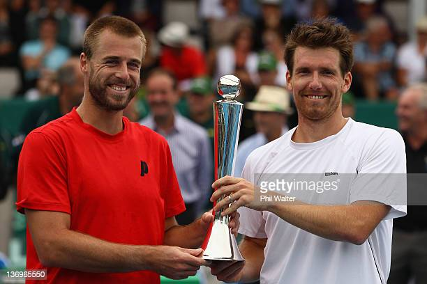 Oliver Marach and Alexander Peya of Austria pose with the trophy following their doubles final match against Frantisek Cermak of the Czech Republic...