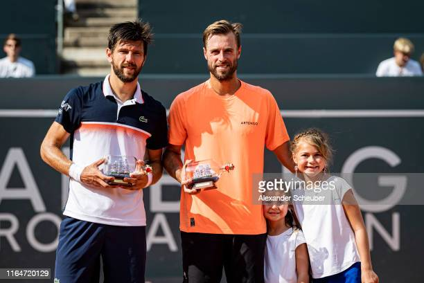 Oliver Marach and Juergen Melzer of Austria celebrate winning the double final during the Hamburg Open 2019 at Rothenbaum on July 28, 2019 in...
