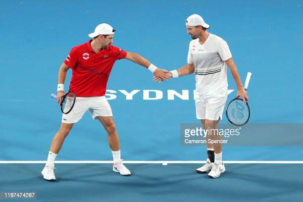 Oliver Marach and Jurgen Melzer of Austria celebrate a point during their Group E doubles match against Ivan Dodig and Nikola Mektic of Croatia...