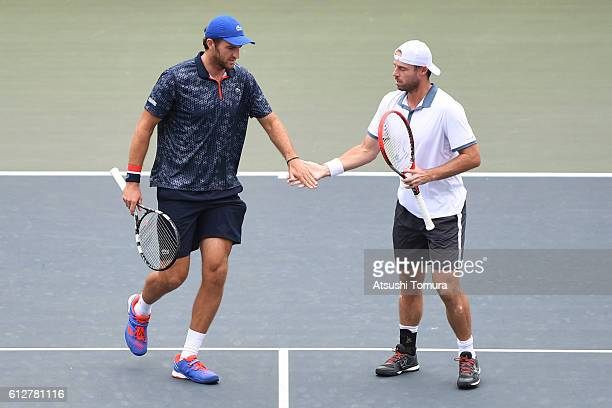 Oliver Marach of Austria and Fabrice Martin of France give a lowfive during the men's doubles first round match against AisamUlHaq Qureshi of...