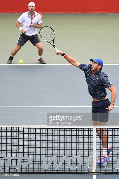 Oliver Marach of Austria and Fabrice Martin of France in action during the men's doubles first round match against AisamUlHaq Qureshi of Pakistan and...