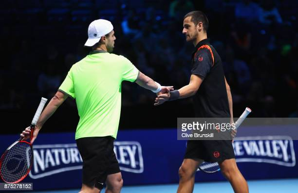 Oliver Marach of Austria and Mate Pavic of Croatia celebrate a point in their Doubles match against Bob and Mike Bryan of the United States during...