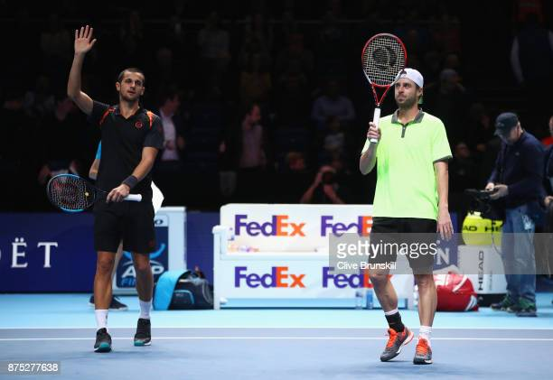 Oliver Marach of Austria and Mate Pavic of Croatia celebrate victory in their Doubles match against Bob and Mike Bryan of the United States during...