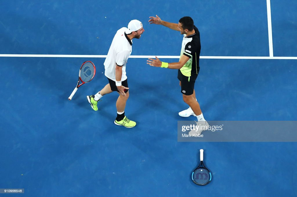 Oliver Marach of Austria and Mate Pavic of Croatia celebrate winning the Men's Doubles Final against Juan Sebastian Cabal of Colombia and Robert Farah of Colombia on day 13 of the 2018 Australian Open at Melbourne Park on January 27, 2018 in Melbourne, Australia.