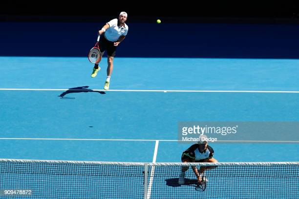 Oliver Marach of Austria and Mate Pavic of Croatia compete in their men's doubles quarterfinal match against Marcus Daniell of New Zealand and...