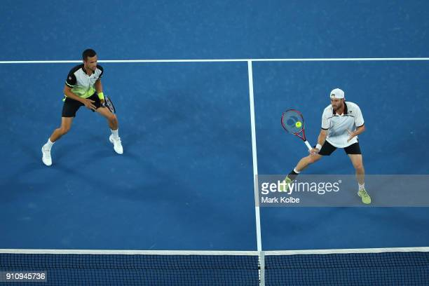 Oliver Marach of Austria and Mate Pavic of Croatia compete in their Men's Doubles Final against Juan Sebastian Cabal of Colombia and Robert Farah of...
