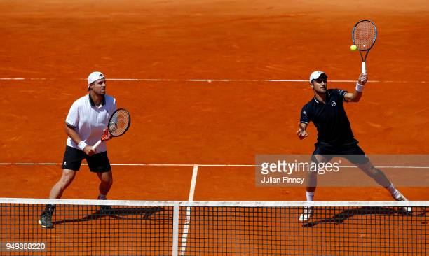 Oliver Marach of Austria and Mate Pavic of Croatia in action against Bob and Mike Bryan of USA in the doubles final during day eight of the ATP...