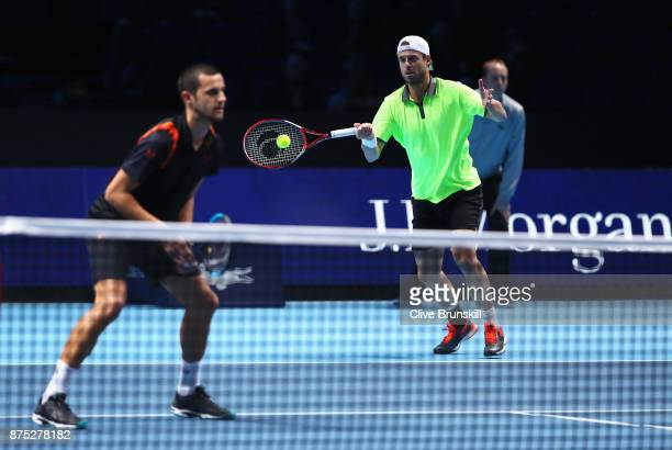 Oliver Marach of Austria and Mate Pavic of Croatia in action in their Doubles match against Bob and Mike Bryan of the United States during day six of...