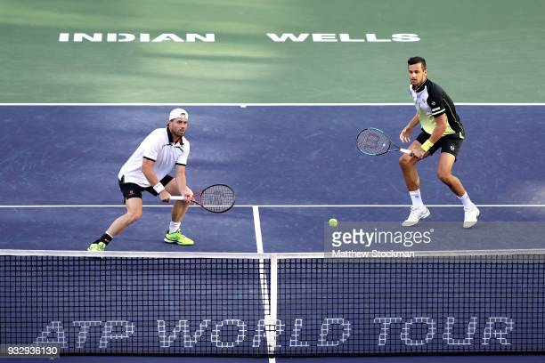 Oliver Marach of Austria and Mate Pavic of Croatia play John Isner and Jack Sock during the doubles semifinals of the BNP Paribas Open at the Indian...