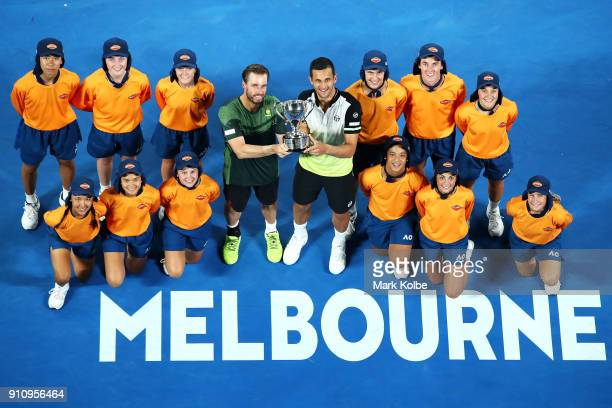 Oliver Marach of Austria and Mate Pavic of Croatia pose for a photo with the championship trophy and the ball kids after winning the Men's Doubles...