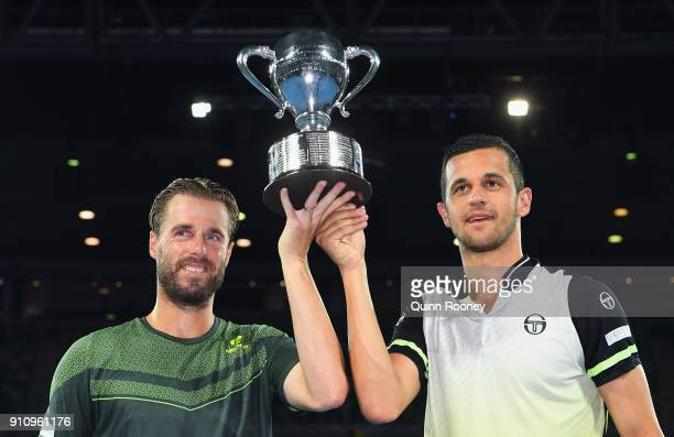 Oliver Marach of Austria and Mate Pavic of Croatia pose for a photo with the championship trophy after winning the Men's Doubles Final against Juan...