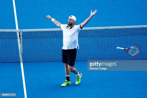 Oliver Marach of Austria celebrates his win with partner Mate Pavic of Croatia in the men's doubles quarterfinal match against Marcus Daniell of New...