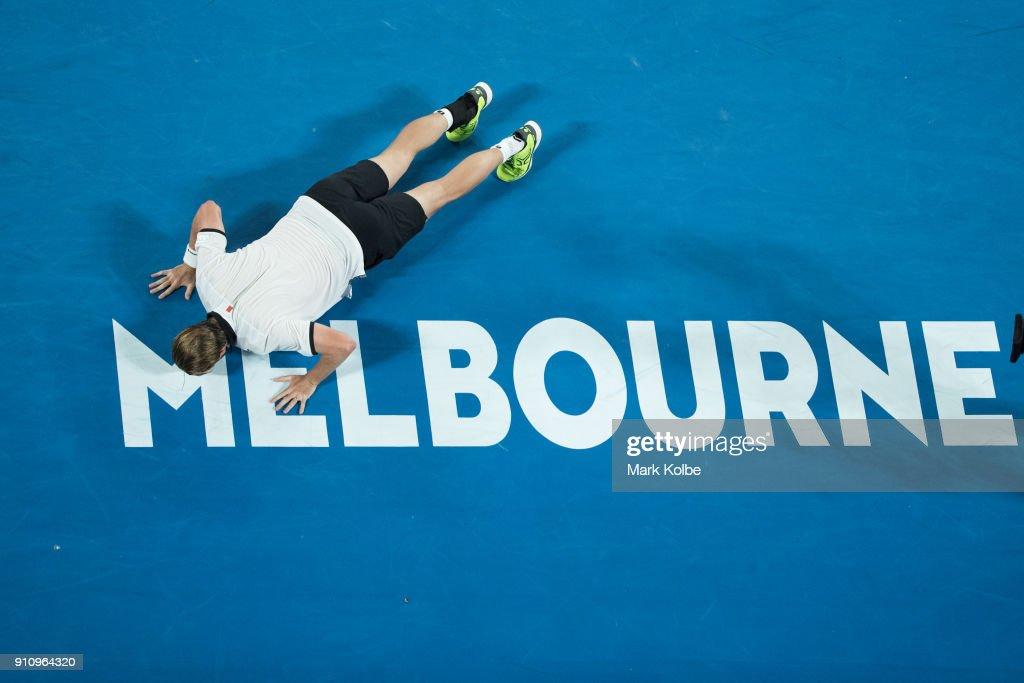 Oliver Marach of Austria playing with Mate Pavic of Croatia kisses the Melbourne sign on the court as he celebrates winning their men's doubles final match against Robert Farah and Juan Sebastian Cabal of Colombia on day 13 of the 2018 Australian Open at Melbourne Park on January 27, 2018 in Melbourne, Australia.