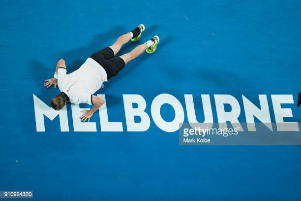 Oliver Marach of Austria playing with Mate Pavic of Croatia kisses the Melbourne sign on the court as he celebrates winning their men's doubles final...