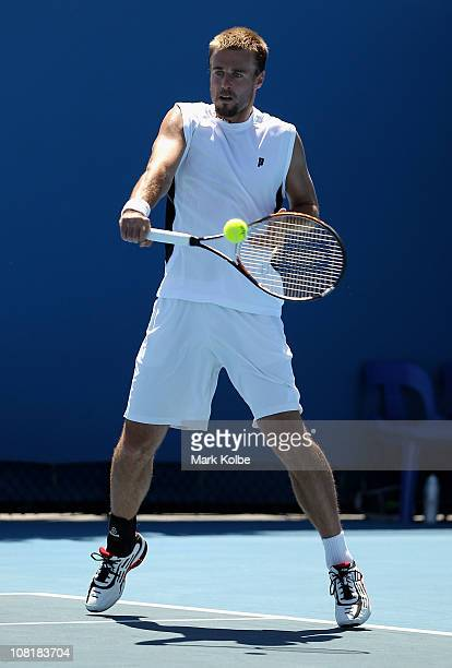 Oliver Marach of Austria plays a backhand during his first round doubles match with partner Lukasz Kubot of Poland against Stephen Huss of Australia...