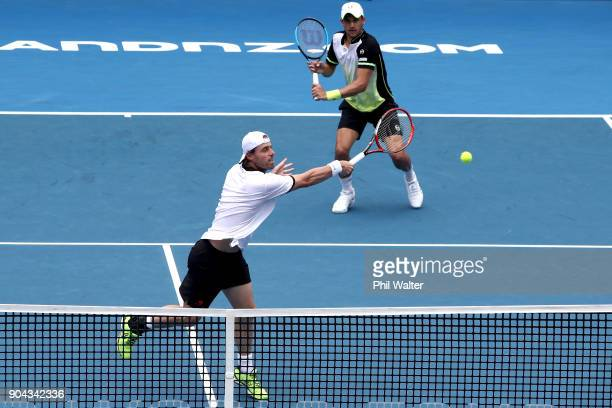 Oliver Marach of Austria plays a backhand with Mate Pavic of Croatia during their Mens Doubles Final against Philipp Oswald of Austria and Max Mirnyi...